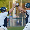 RYAN HUTTON/ Staff photo<br /> Danvers' Zach Dillon, left, celebrates with teammate Max Paul, right, after the latter hit a sacrifice fly ball to help Dillon score the first run of Wednesday night's game during the bottom of the fourth.