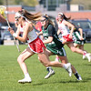 HADLEY GREEN/ Staff photo<br /> Masco's Grace Fahey (16) runs down the field as Manchester Essex's Drew Charlton (21) plays defense at the Masco v. Manchester Essex girls varsity lacrosse game held at Masconomet High School. 5/12/17