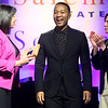 HADLEY GREEN/ Staff photo<br /> Salem Mayor Kim Driscoll and Salem State President Patricia Maguire Meservey present singer-songwriter John Legend the inaugural Salem Advocate for Social Justice award. The event took place at Salem State's Rockett Arena on Tuesday, May 2nd, 2017.