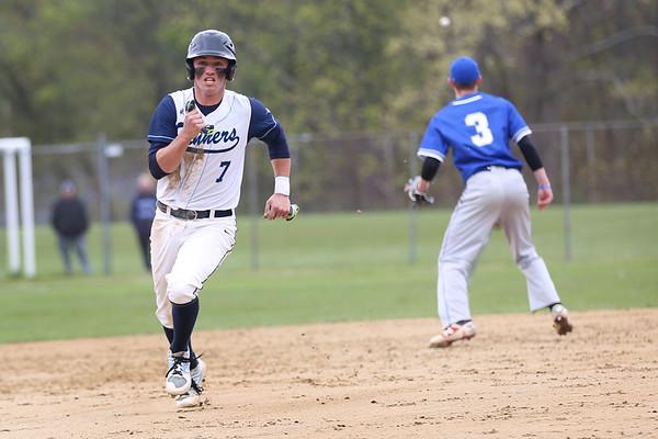 HADLEY GREEN/ Staff photo<br /> Peabody's Jake Gustin (7) runs from second to third base at the Peabody v. Braintree boys varsity baseball game at Peabody Veterans Memorial High School. 5/13/17