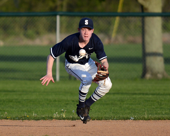 RYAN HUTTON/ Staff photo<br /> Swampscott's Spencer Perkins moves to field the ball in the bottom of the second inning of Wednesday's game at Danvers.