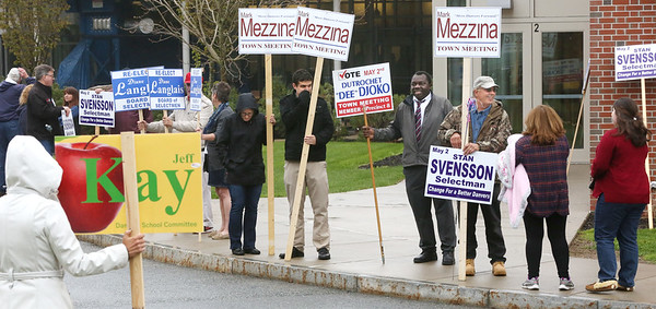 holding signs outside the Danvers High