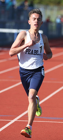 HADLEY GREEN/ Staff photo<br /> Peabody's Shane Braz comes in first for the boy's two mile race at the NEC track championships at Peabody High School. 5/20/17