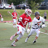 HADLEY GREEN/ Staff photo<br /> Masco's Tommy Jung (5) runs with the ball while Beverly's Nick DiLuiso (1) plays defense at the Beverly v. Masconomet seventh annual North Shore Cup at Beverly High School. 5/24/17