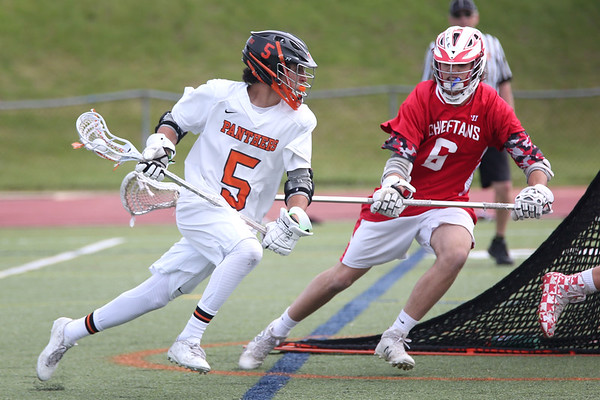 HADLEY GREEN/ Staff photo<br /> Beverly's Sam Abate (5) runs towards the net while and Masco's Max Sherriff-Streng (6) defends him at the Beverly v. Masconomet seventh annual North Shore Cup at Beverly High School. 5/24/17