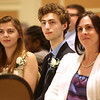 HADLEY GREEN/ Staff photo<br /> From left, Briana Pinto, Alec Austraw, both seniors at Salem Academy, and Melissa Lassen, a counselor at Salem Academy, listen to Salem State President Patricia Meservey speak at the 49th Annual Honor Scholars Recognition Dinner held at the Doubletree Hotel in Danvers. 5/9/17