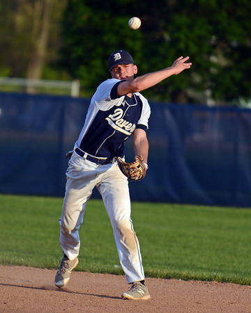 RYAN HUTTON/ Staff photo<br /> Danvers' Tommy Mento fires the ball to first to make an out in the top of the third inning of Wednesday's home game against Swampscott.