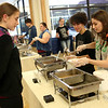 HADLEY GREEN/ Staff photo<br /> Nina Vitale and Madalaine Quintiliani, both seniors at Bishop Fenwick High School, serve soup during Haven from Hunger's annual Empty Bowl Dinner fundraiser at Peabody High. 5/4/17