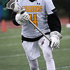 HADLEY GREEN/ Staff photo<br /> Bishop Fenwick's Brian Harrington (4) runs up the field at the Bishop Fenwick v. Medford lacrosse game at Bishop Fenwick High School. 5/24/17