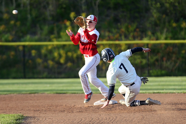 HADLEY GREEN/ Staff photo<br /> Masco's Will Hunter (4) prepares to catch the ball as Swampscott's Louis Olivieri (7) slides into second base at the Swampscott v. Masco boys baseball game at Swampscott Middle School. 5/12/17