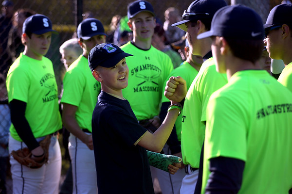 HADLEY GREEN/ Staff photo<br /> Nathan DeRoche greets members of the Swampscott boys varsity baseball team at a fundraiser held at the Swampscott v. Masco baseball game for DeRoche, who is battling cancer. 5/12/17