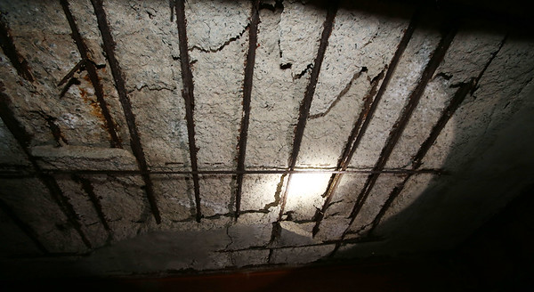 Beverly Chief Paul Cotter looks at the deteriorating ceiling