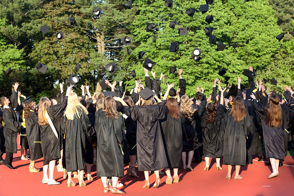 HADLEY GREEN/ Staff photo<br /> Students throw their caps into the air after the ceremony concludes. 5/19/17