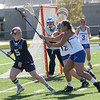 HADLEY GREEN/ Staff photo<br /> Peabody's Lauren Wolff (5) cuts to avoid Danvers' defenders Becca Cummings (12) and Grace Leete (23)  at the Danvers v. Peabody girls varsity lacrosse game at Danvers High School. 5/10/17