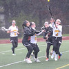 HADLEY GREEN/ Staff photo<br /> Bishop Fenwick's Maddy Bethune (4) vies for the ball surrounded by players on both teams at the Bishop Fenwick v. Ipswich lacrosse game at Bishop Fenwick High. 5/5/17