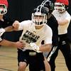 KEN YUSZKUS/Staff photo. Pingree senior football player John Lucey at practice on Monday.    11/24/14