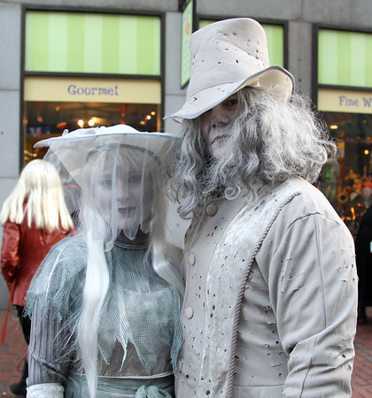 DAVID LE/Staff photo. Irene and Dan Pimentel, of Rhode Island, dressed up as ghosts as they walked around the Essex Street Pedestrian Mall on Saturday afternoon. 10/31/15.