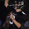 DAVID LE/Staff photo. Marblehead senior quarterback Garret Keough (13) drops back to pass against Gloucester. 11/6/15.