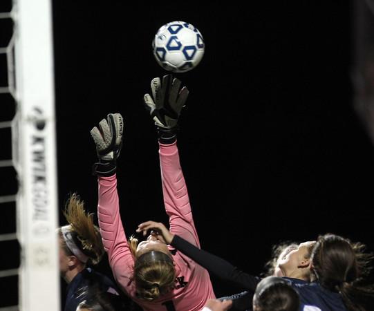 DAVID LE/Staff photo. Bishop Fenwick senior goalie Merry Harrington makes a leaping save on a Swampscott corner. 11/10/15.