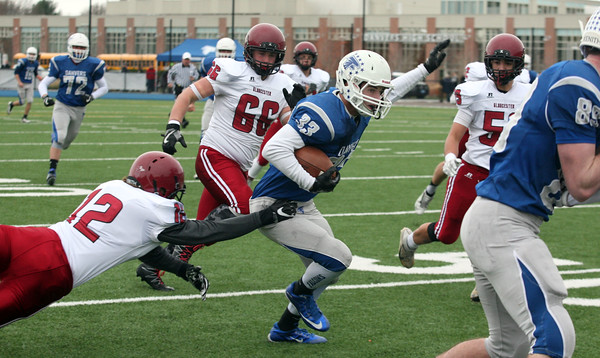 Quintin Holland, #33 for Danvers is tackled by Matthew Smith, 12, from  Gloucester during the first half of theannual Thanksgiving Day football game played at Deering Stadium.  Danvers won 41-26.<br /> Nov. 24, 2016