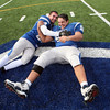 Danvers captain Quintin Holland, left,  celebrates with teammate Bruno Abbatessa.  Danvers beat Gloucester during the annual Thanksgiving Day game 41-26 .<br /> Nov. 24, 2016
