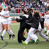 HADLEY GREEN/Staff photo<br /> Danvers players celebrate after Lydia Runnals (1) scores the winning penalty kick after two overtimes at the Medway v. Danvers Division 2 girls soccer state championship game at Fitchburg State University.<br /> <br /> 11/18/17