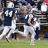 HADLEY GREEN/Staff photo<br /> Hamilton-Wenham's Jake Lanciani (3) runs to the end zone to score two points after Arlington Catholic fumbled a two-point conversion at the Hamilton-Wenham v. Arlington Catholic Division 6 North playoff semifinals football game at Hamilton-Wenham High School.<br /> <br /> 11/04/17