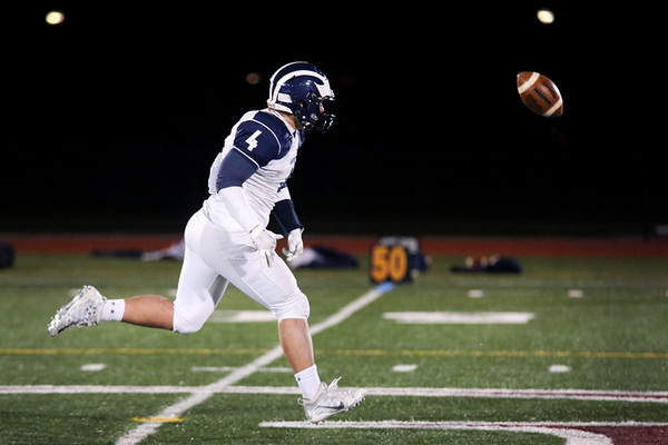 HADLEY GREEN/Staff photo<br /> Swampscott's Dylan January (4) runs towards the ball at the Gloucester v. Swampscott football game at Gloucester High School.<br /> 11/10/17