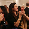 HADLEY GREEN/Staff photo<br /> Laura Player of Windover Construction in Beverly applauds at the North Shore Chamber dinner and distinguished leaders awards ceremony.<br />  <br /> 11/15/17