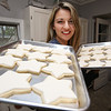 Ken Yuszkus/Staff photo      Aime Pope with trays of undecorated cookies that need finishing. She was recently featured in a Christmas cookie baking competition on The Food Network.      11/3/17