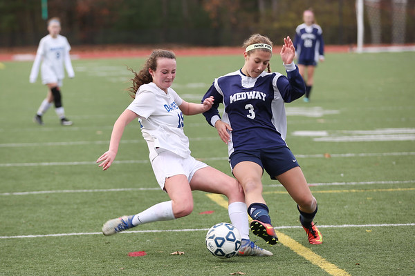 HADLEY GREEN/Staff photo<br /> Danvers' Riley Baker (19) and Medway's Heather Scheid (3) vie for the ball at the Medway v. Danvers Division 2 girls soccer state championship game at Fitchburg State University.<br /> <br /> 11/18/17