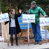 HADLEY GREEN/Staff photo<br /> Beverly city council candidate Julie Flowers holds signs with Paul Hansen-Mitev outside the Centerville School polling center in Beverly.<br /> 11/07/17