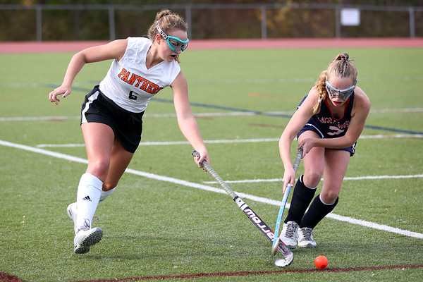 HADLEY GREEN/Staff photo<br /> Beverly's Natalie Matthews (6) runs towards the ball as Lincoln-Sudbury's Isabelle Acquaviva (7) plays defense at the Beverly v. Lincoln-Sudbury field hockey playoff game at Beverly High School. 11/02/17