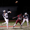 HADLEY GREEN/Staff photo<br /> Swampscott's Colin Fray (5) makes a pass at the Gloucester v. Swampscott football game at Gloucester High School.<br /> 11/10/17
