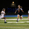HADLEY GREEN/Staff photo<br /> Beverly's Klaudia Rushi (9) dribbles the ball while Danvers' Abbi Clickstein (9) and Madison Pesce (15) play defense at the Danvers v. Beverly Division 2 North quarterfinal girls soccer game at Danvers High School.<br /> <br /> 11/04/17