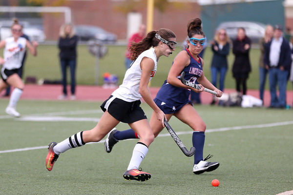 HADLEY GREEN/Staff photo<br /> Beverly's Abbey Otterbein (10) runs up the field while Lincoln-Subury's Mackenzie Madden (12) plays defense at the Beverly v. Lincoln-Sudbury field hockey playoff game at Beverly High School. 11/02/17