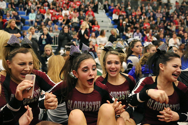 HADLEY GREEN/Staff photo<br /> From left, cheerleaders Kyriah Smithson, Matina Billante, Rilee Newhall, and Jillian Gross react after Gloucester wins first place in the small school co-ed division at the Massachusetts State Cheerleading Tournament at Worcester State University.<br /> <br /> 11/19/17
