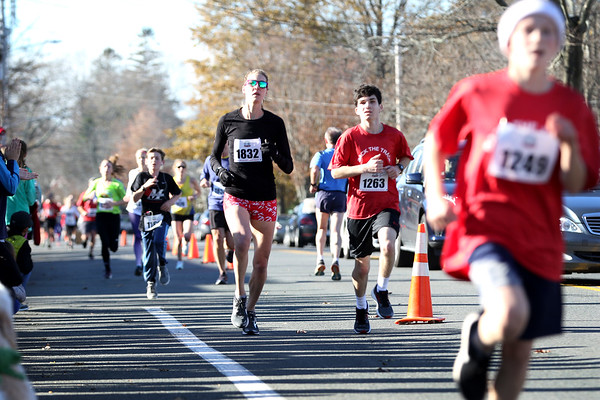 HADLEY GREEN/Staff photo<br /> Runners near the finish line of the Back the Track 5K in Marblehead. <br /> <br /> 11/25/17