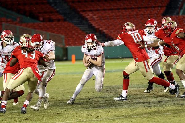 HADLEY GREEN/Staff photo<br /> Masconomet's Peter Kitsakos (23) runs the ball through the middle at the Masconomet v. Everett football game at Fenway Park.<br /> <br /> 11/22/17