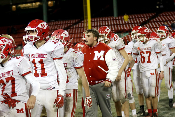HADLEY GREEN/Staff photo<br /> Masconomet players shake hands with Everett after coming short at the Masconomet v. Everett football game at Fenway Park.<br /> <br /> 11/22/17