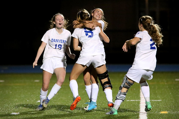 HADLEY GREEN/Staff photo<br /> Danvers' Hannah Lejeune (8) hugs her teammates after scoring against Beverly at the Danvers v. Beverly Division 2 North quarterfinal girls soccer game at Danvers High School.<br /> <br /> 11/04/17