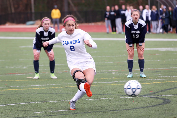 HADLEY GREEN/Staff photo<br /> Danvers' Hannah Lejeune (8) shoots at the Medway v. Danvers Division 2 girls soccer state championship game at Fitchburg State University.<br /> <br /> 11/18/17