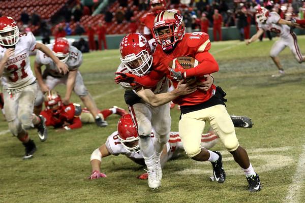 HADLEY GREEN/Staff photo<br /> Masconomet's Peter Kitsakos (23) tackles Everett's Jaden Mahabir (19) at the Masconomet v. Everett football game at Fenway Park.<br /> <br /> 11/22/17