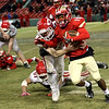 HADLEY GREEN/Staff photo<br /> Masconomet's Peter Kitsakos (23) tackles Everett's Jaden Mahabir (19) at the Masconomet v. Everett football game at Fenway Park.<br /> <br /> 11/22/17