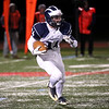 HADLEY GREEN/Staff photo<br /> Swampscott's Jacke McIntire (14) runs with the ball at the Gloucester v. Swampscott football game at Gloucester High School.<br /> 11/10/17