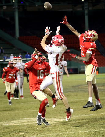 HADLEY GREEN/Staff photo<br /> Masconomet's Jack Seymour (14) jumps for a pass at the Masconomet v. Everett football game at Fenway Park.<br /> <br /> 11/22/17