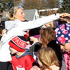 HADLEY GREEN/Staff photo<br /> Marblehead native and recent New York City Marathon women's champion Shalane Flanagan fist-bumped young runners at the start line of the Kids Fun Run at the fourth annual Back the Track 5K in Marblehead. 11/25/17