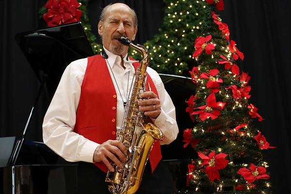 HADLEY GREEN/Staff photo<br /> Robert Landoni plays the saxophone at the Swedish Yule Fair at the Hamilton-Wenham Community House.<br /> <br /> 11/25/17