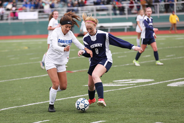 HADLEY GREEN/Staff photo<br /> Danvers' Rebecca Rocker (5) moves the ball up the field while Medway's Meghan Foley (8) plays defense at the Medway v. Danvers Division 2 girls soccer state championship game at Fitchburg State University.<br /> <br /> 11/18/17
