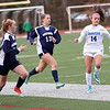 HADLEY GREEN/Staff photo<br /> Danvers' Abigail Cash (14) dribbles the ball through Medway defenders at the Medway v. Danvers Division 2 girls soccer state championship game at Fitchburg State University.<br /> <br /> 11/18/17